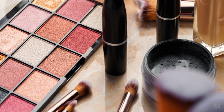 QC Makeup Academy blog post, cosmetic products on table