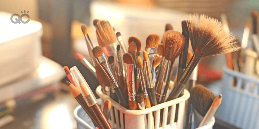 makeup brushes in container on table
