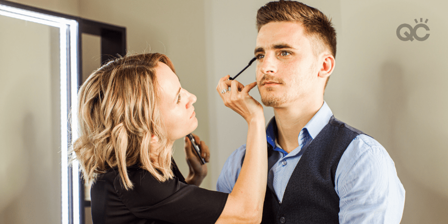 makeup artist working on male client