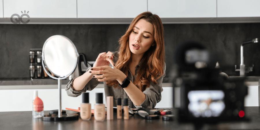makeup artist filming herself on camera