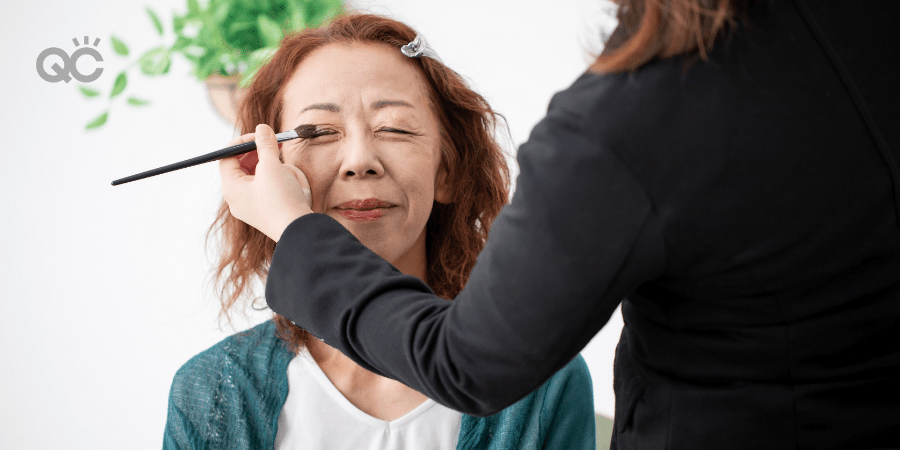 makeup artistry applying makeup to older woman's face