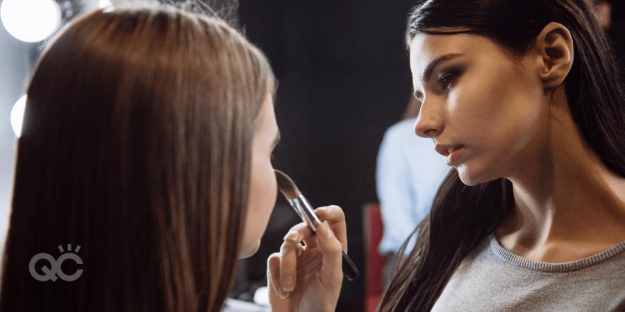 makeup artist doing editorial makeup on model