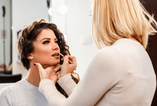 makeup artist jobs article, mar 30 2021, feature image, makeup artist working on client