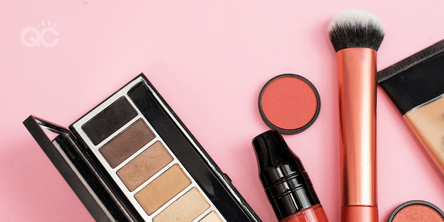makeup products against pink background