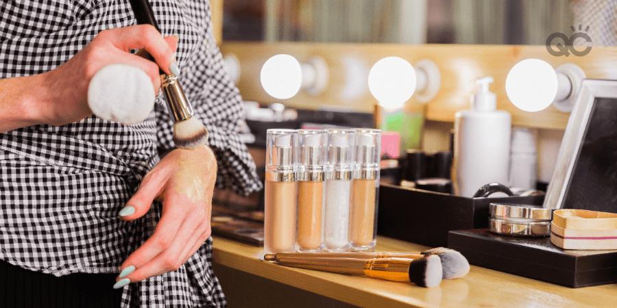 makeup artist blending foundation on hand