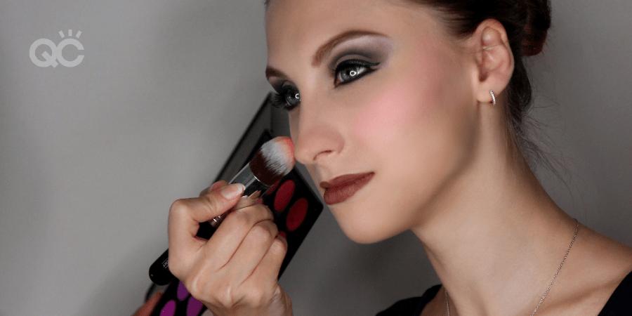 Makeup artist, Veronika Kelle, appying makeup on client's face
