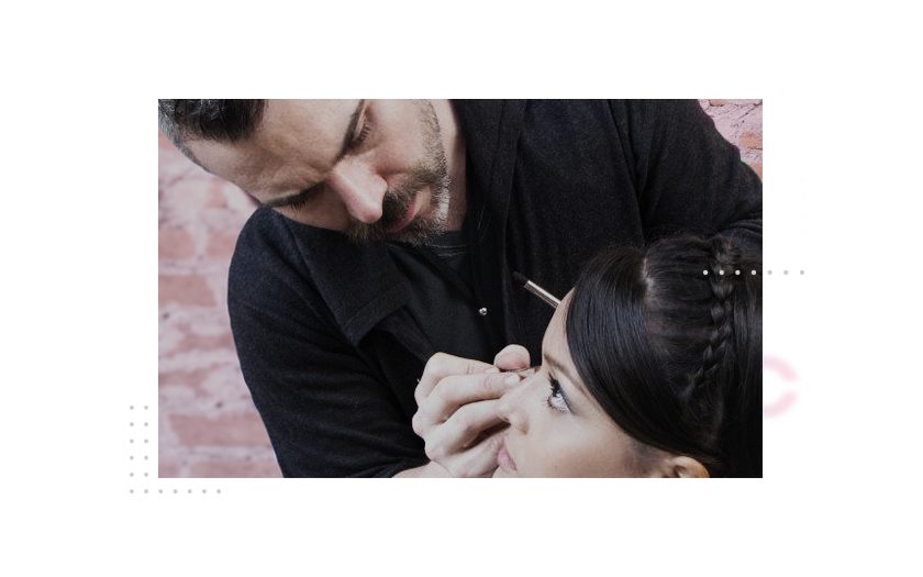 Nathan Johnson applying makeup on client