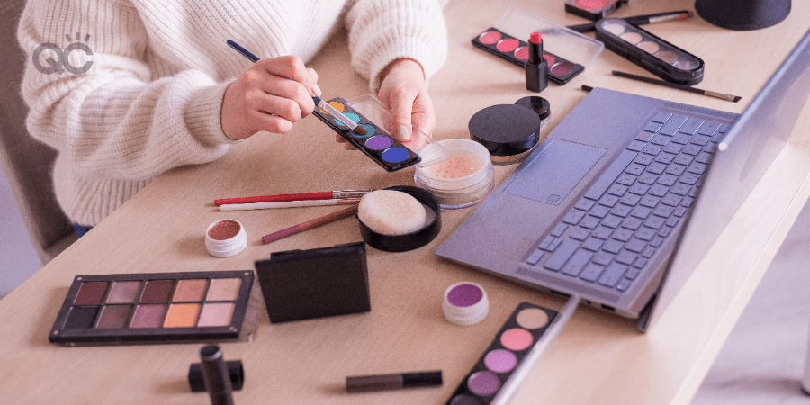 makeup career article in-post image, makeup artist doing makeup in front of laptop