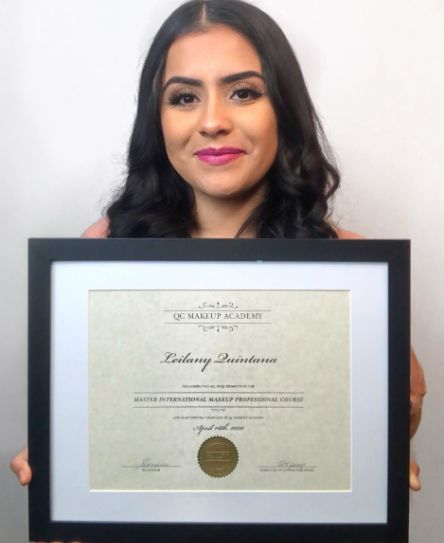 QC Makeup Academy graduate, Leilany Quintana, holding up certification