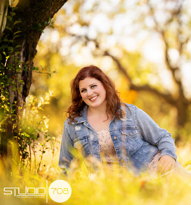 Beautiful woman sitting in field
