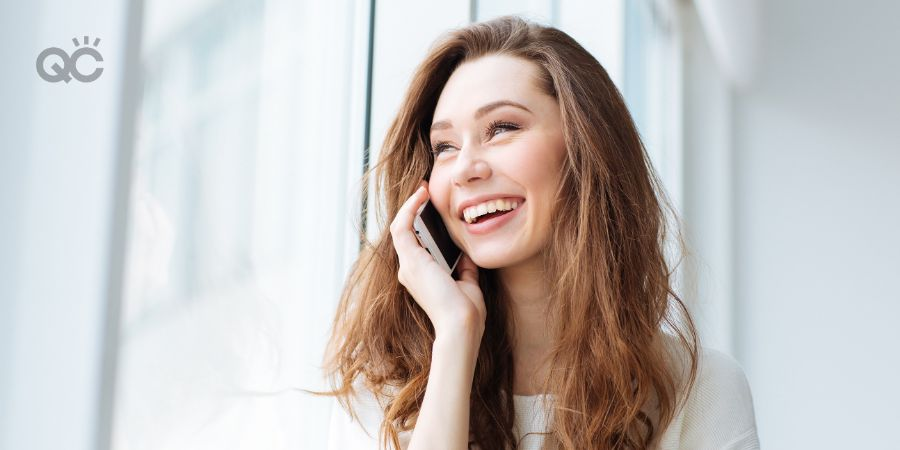Happy woman on phone at home