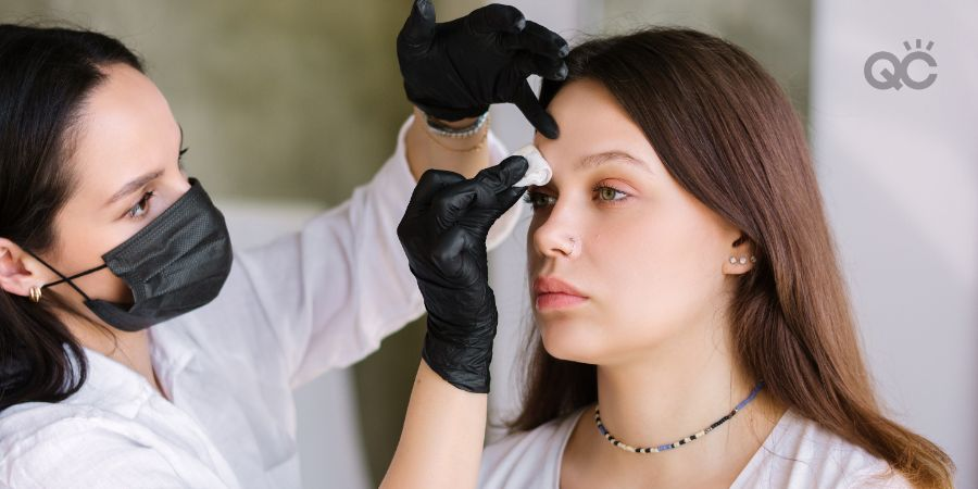 Makeup artist removing makeup from client's face