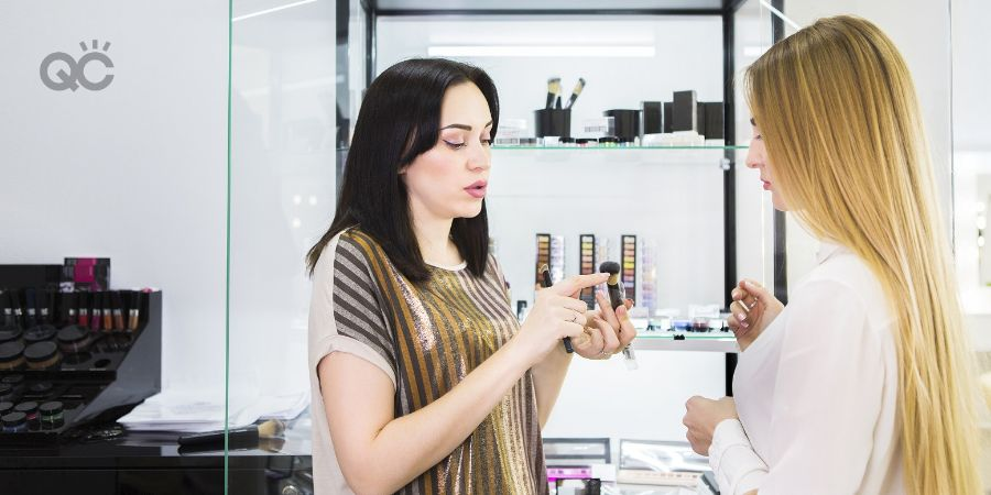 Skincare expert helping client at beauty counter