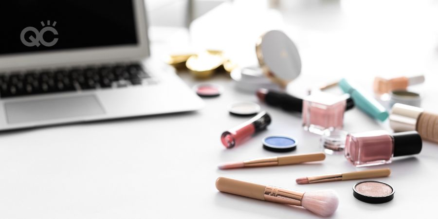 Makeup products for woman and laptop on table