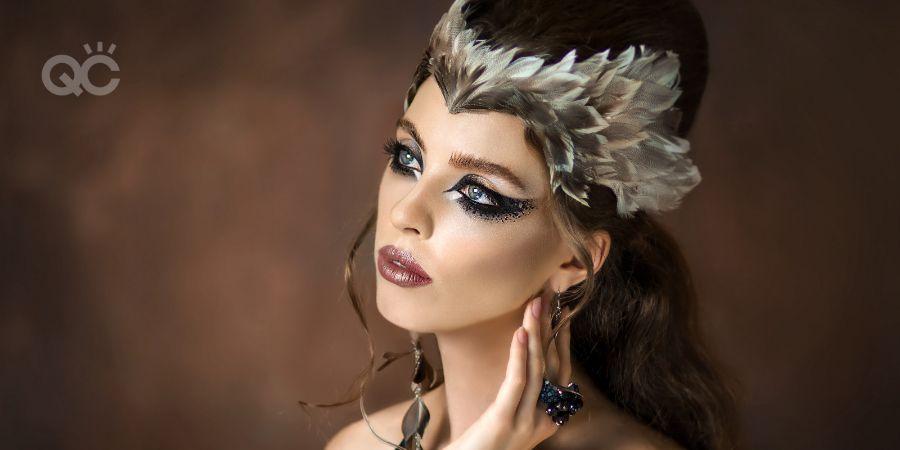 Beautiful tender girl in the ornaments of feathers. Tender girl in the form of a bird. Girl bird Very beautiful young girl. Fairy makeup. Fantasy makeup.