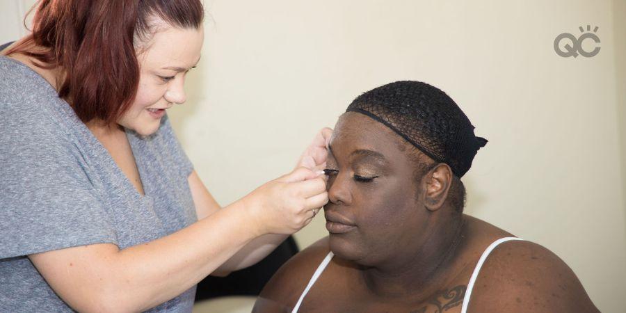Erica Cano portfolio image, Erica working on client's makeup